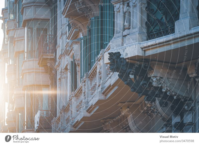 Detail of a neoclassical building under the last lights of the sunset color outdoor exterior architecture architectural architectonic urban city balconies