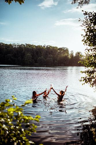 Three friends in the lake enjoy the summertime memory Light Serene Summer feeling Swimming & Bathing Lake Pond Nature Beautiful weather Contentment Friendship