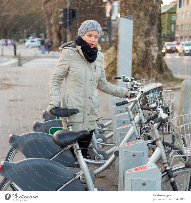 Station of urban bicycles for rent. woman public transport keyboard station transportation citibike dialpad city rental environment row lifestyle hire wheel