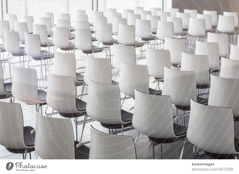 Empty white chairs in contemporary conference hall with lecture hall architecture business auditorium classroom presentation seat row nobody empty education