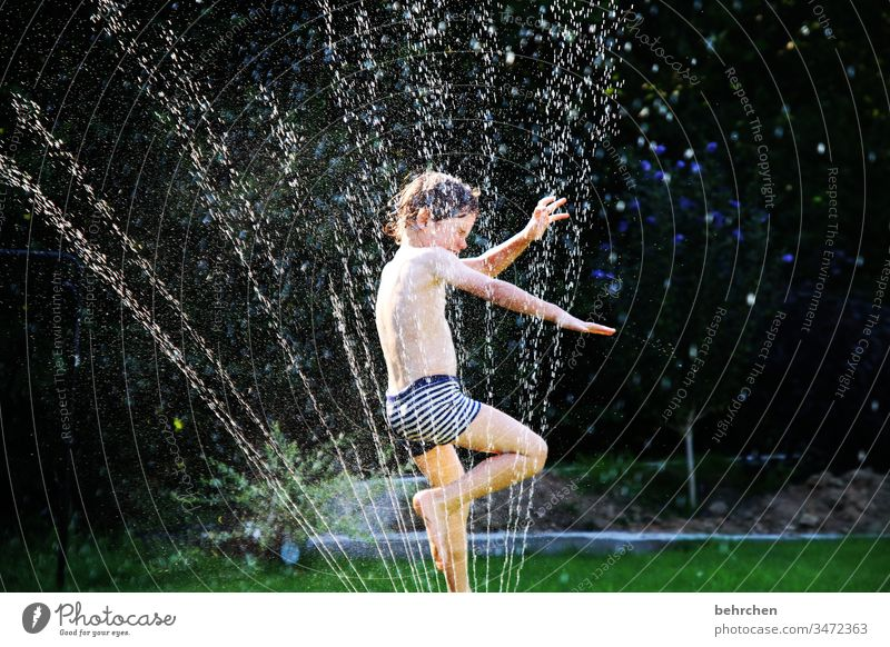 #1600* hop take a shower spring Family & Relations refreshingly muck about summer feeling Fresh Effervescent Wet Colour photo Exterior shot Sunlight