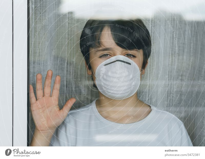 Quarantined child by the Coronavirus pandemic with mask medical coronavirus epidemic quarantine sad covid-19 symptom medicine health childhood sadness positive