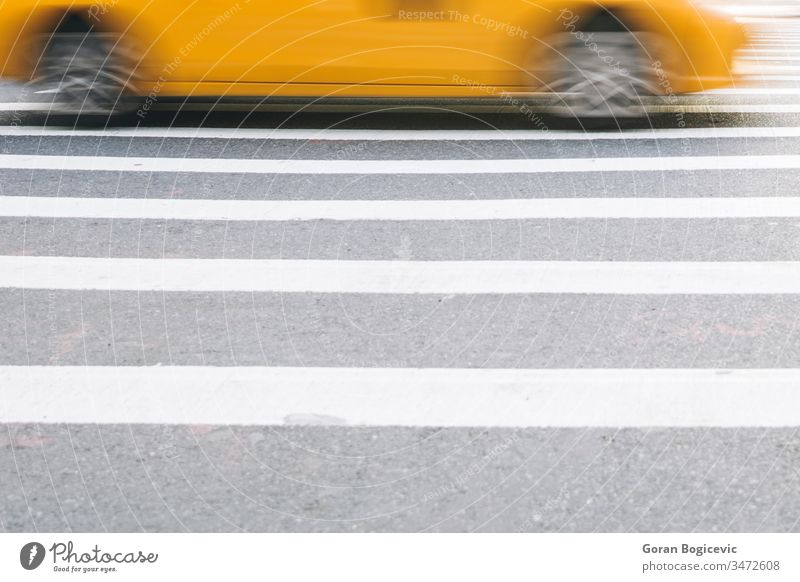 Abstract blur of urban street scene with a yellow taxi cab in New York, United States america american broadway business busy car city commercial manhattan