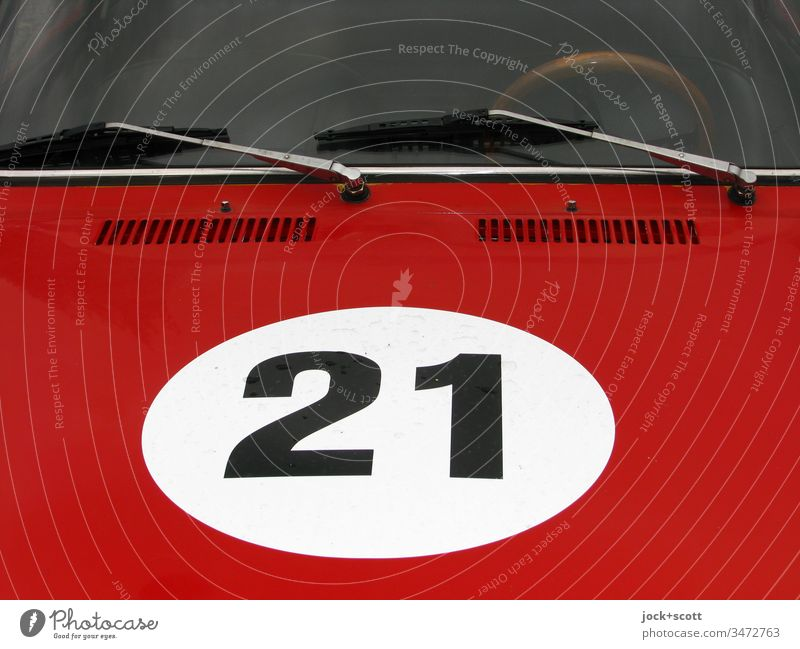 No. 21 in white circle on bonnet, painted red Style Motorsports Vintage car Car Sports car Digits and numbers Nostalgia Car body Day Motor vehicle Detail