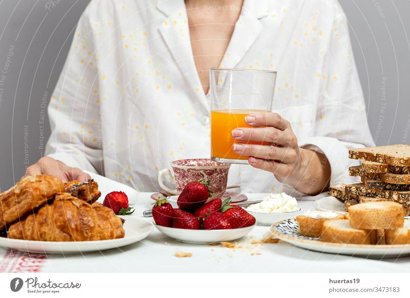 Unrecognizable woman having breakfast in pajamas at home in quarantine food morning lifestyle unrecognizable coronavirus covid-19 female eating white fresh