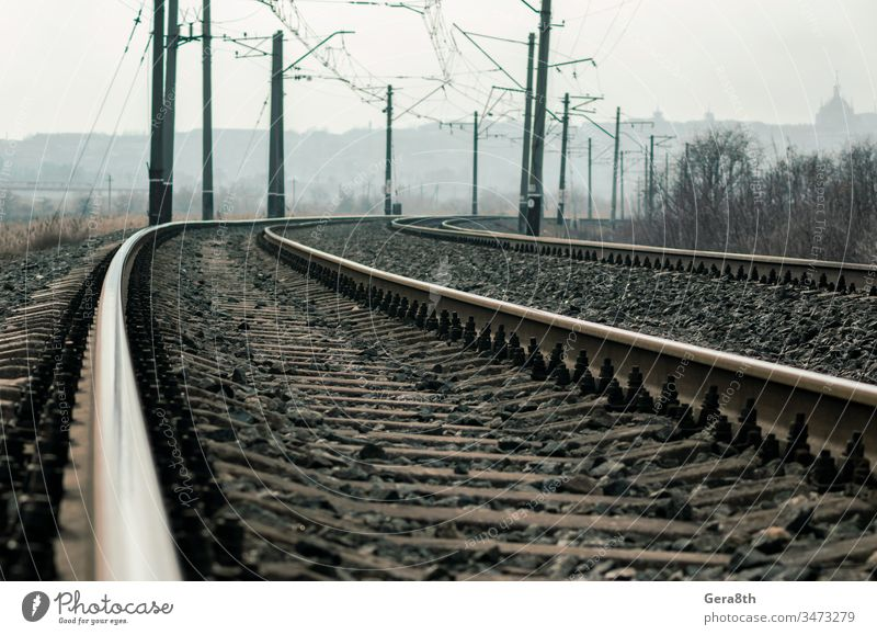old railroad rails and poles with wires background day deserted desolate diraction. steel elevated gloomy industry iron landscape line metal nature no people