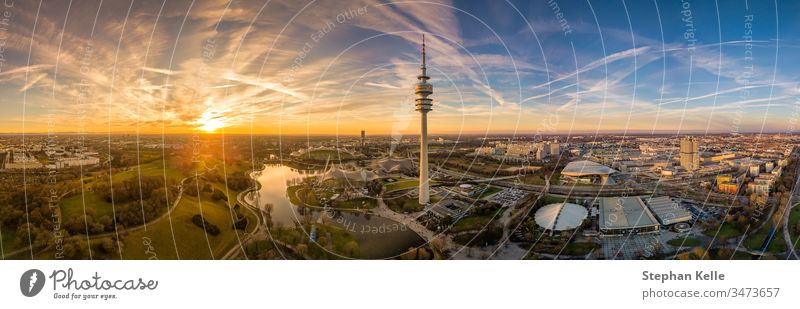 Panoramic aerial view at sunset over Munichs Olympic park. munich olympiapark copy space drone colorful mood evening dawn orange german popular tower tourism
