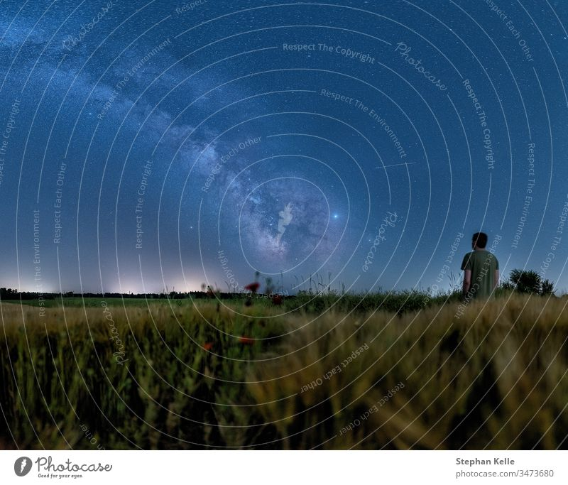 Man watching the milky way standing at a growing field at night man milkyway space galactical centre starlight astrophotography background nature galaxy sky