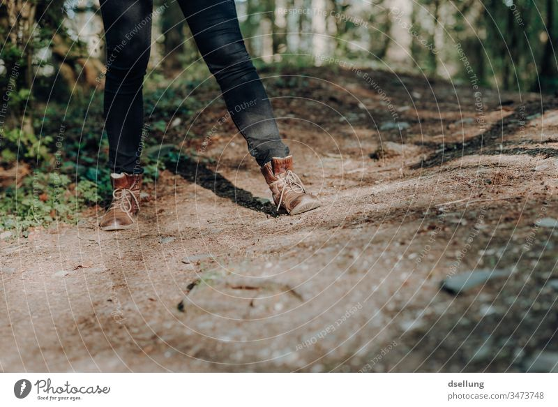 Legs of a young woman with black jeans and brown leather boots on a forest path Lanes & trails off Footwear Lifestyle Hiking Woman Woman's leg Vacation & Travel