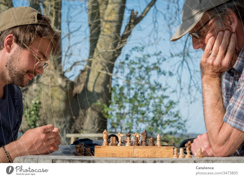 A game of chess in the fresh spring air in quarantine chess game Chessmen King queen Battle Competition Chessboard Tower Runner strategy peasant think Tree