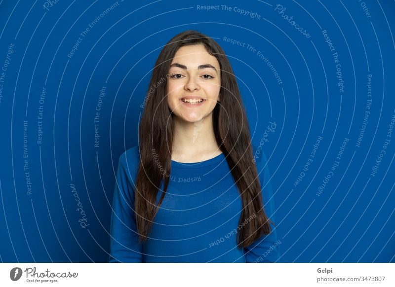 Brunette young girl wearing blue jersey person smile relaxed looking at camera laugh joy glad joyful self-confidence portrait expression gesture beautiful