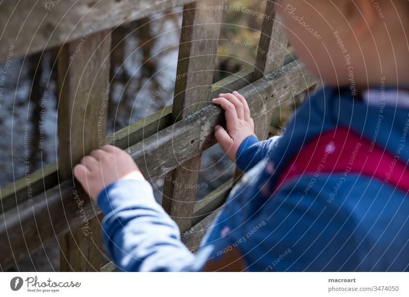 Child holds on to railing corona out girl Playing Handrail kita cordon zooz Fence Nature Forest To go for a walk Discover by hand children's hands