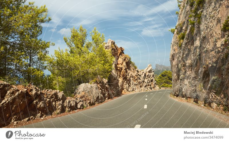 Scenic mountain road on Mallorca coast, Spain drive trip journey summer holiday rock empty nature landscape scenic