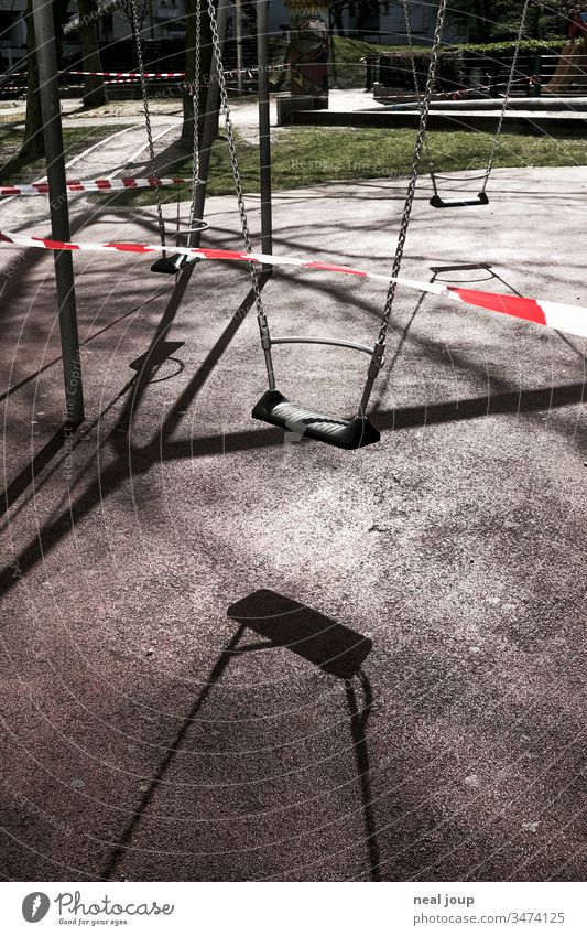 playground, swing, barrier tape Back-light Shadow Swing Playground Exterior shot Barred cordoned off forbidden corona crisis insulation Deserted Crisis