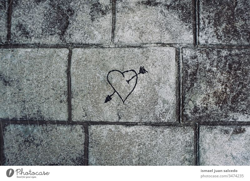 heart on the grey wall on the street, love is in the air arrow paint painting draw drawing gray textured background Draw Painting and drawing (object)