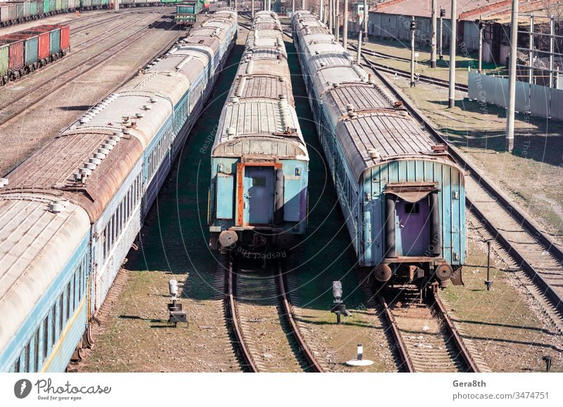 old rusty abandoned trains at a station in Ukraine collapse color colored corruption crisis despondency dirty economy enterprise europe grass green grunge harm