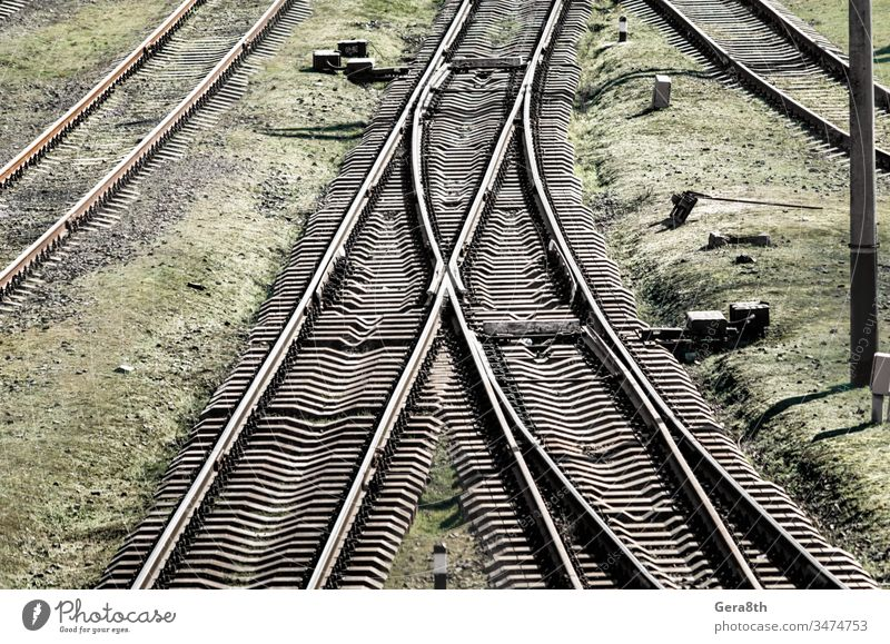 empty old railway in Ukraine colored corruption crisis direction dirty equipment europe grass green grunge industrial industry infrastructure intersection iron