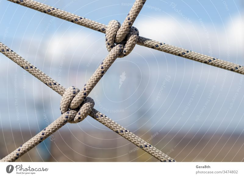 many ropes and one big knot close up abstract abstract background affiliation apposition attachment cable close-up combination communications compound