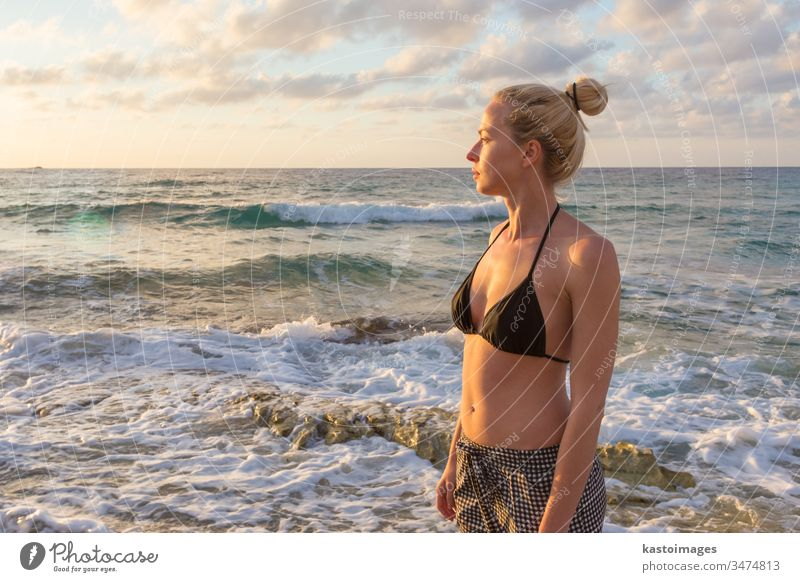 Relaxed Happy Woman Enjoying Sun on Vacations. woman nature free beach happy summer carefree relax freedom happiness young wellness girl beautiful beauty