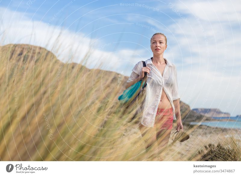 Free Happy Woman Enjoying Sun on Vacations. woman free sea freedom island looking carefree relax holiday nature happy summer wind happiness beach carry young