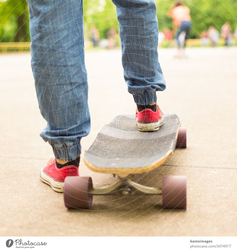 Teenage girl practicing riding long board. urban skateboard sport one lifestyle skateboarding fun skater youth young summer street fashion woman cool casual