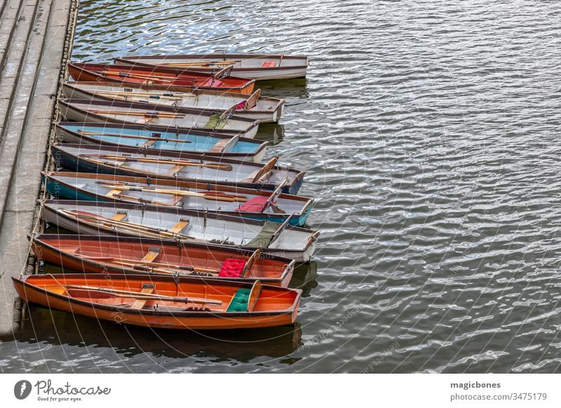 Wooden boats for hire moored on the River Thames activity attraction city colorful colourful day england europe famous kingdom leisure london many nautical old