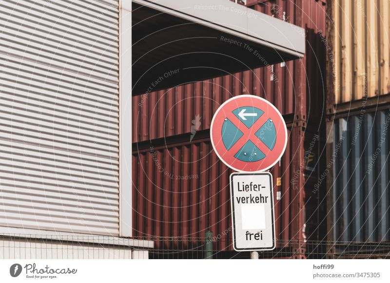 Entry to container terminal - no parking - free delivery traffic Road sign free on delivery Prohibition sign Clearway Container terminal red container Port City