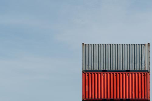 Container in red and grey on top of each other Container terminal Red red container Logistics Industry Navigation Trade Container ship Container cargo Harbour