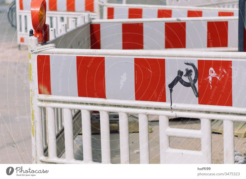 Blocking off construction sites with hammer and sickle symbol Barrier cordon Fence Barque Road construction Construction site Reddish white Repair Protection