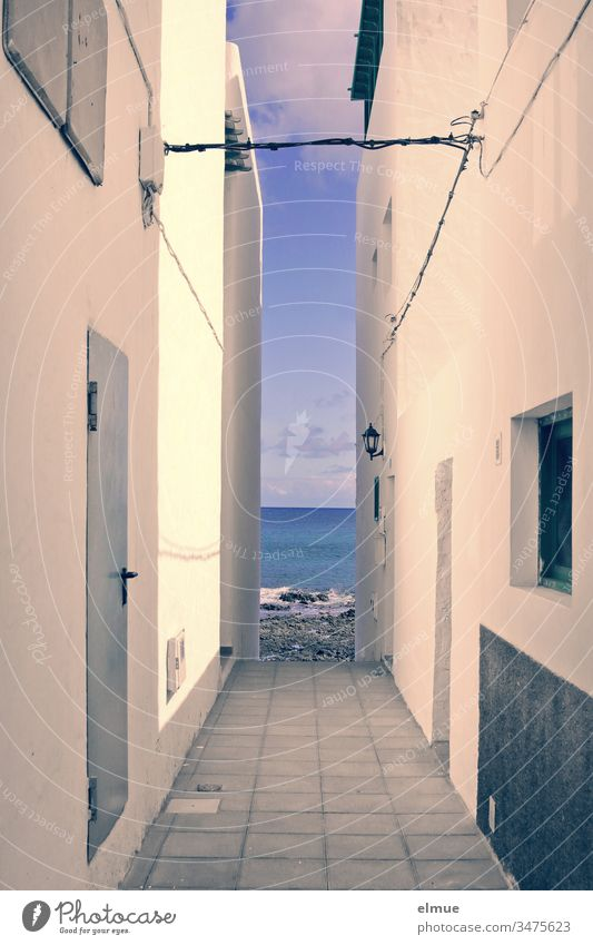 View of the sea through between two houses sea view House (Residential Structure) Narrow Vista Limitation Wall (barrier) Facade Alley Building Built-in Deserted