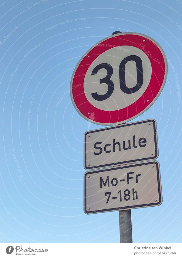 Traffic sign, speed 30, school, Monday to Friday 7-18 Road sign Warning sign Signage School School sign Signs and labeling Characters Exterior shot Deserted