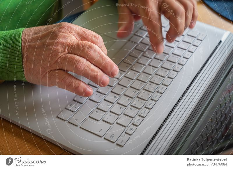 Old man with laptop: contact with the outside world Pensioners communication Internet internet connection Loneliness Quarantine coronavirus Corona virus