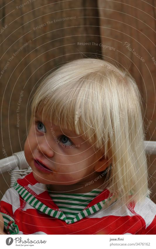 Little girl sitting on a chair looking up portrait Child little girl big eyes natural Brash Cute Parenting observantly listen understand Spellbound Impish