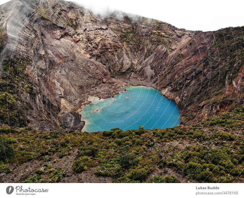 Aerial Volcano Irazú (Irazu) from above with a beautiful blue lake in the Volcano crater, Costa Rica costa rica volcano irazú crater lake drone volcano lake