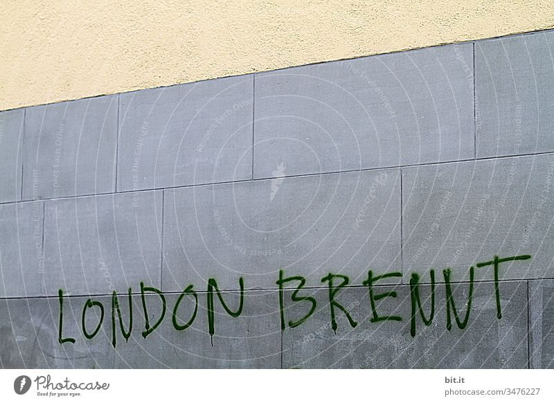 London is burning, written on a wall. England Great Britain Building Demonstration Burn Focal point Town Wall (building) Facade Characters writing Architecture
