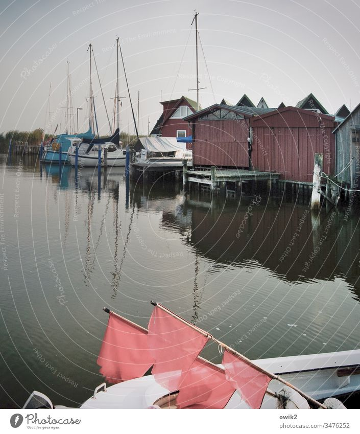 Ahrenshoop, Althagen Harbour Exterior shot Sky Boathouses Simple silent Idyll Peaceful boat flags Signal Buoy boats sailboats Reflection Water Surface of water