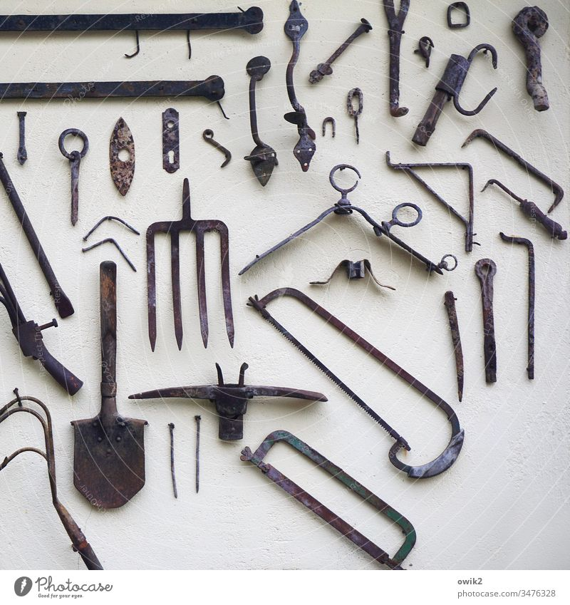 tool kit Wall (building) Tool Saw Spade Fork prongs utensils Metal Things Hang hotchpotch Collection Historic Metal fitting Detail Work and employment