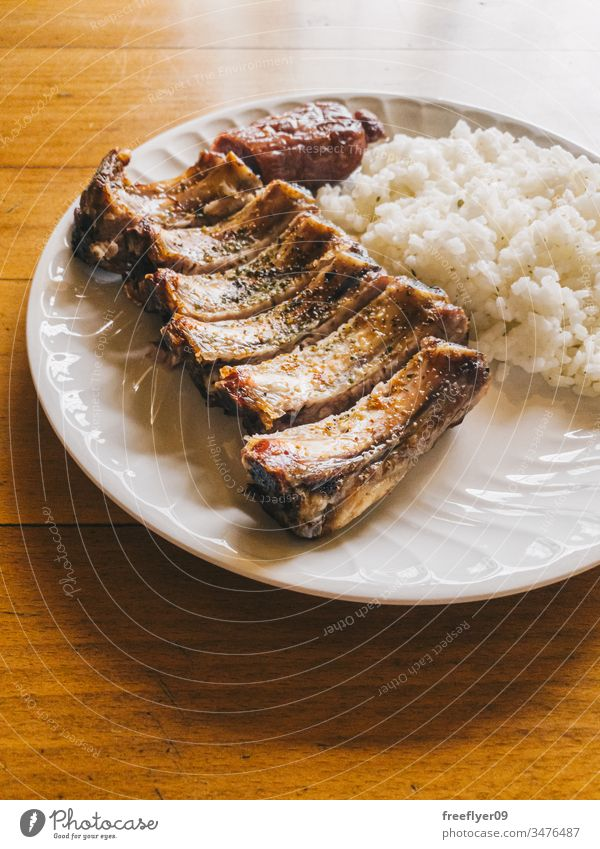 Short ribs with rice and criollo chorizo, typical galician food meat cook bones maple syrup board roasted rip tip barbecue party loin ribs copy space rustic