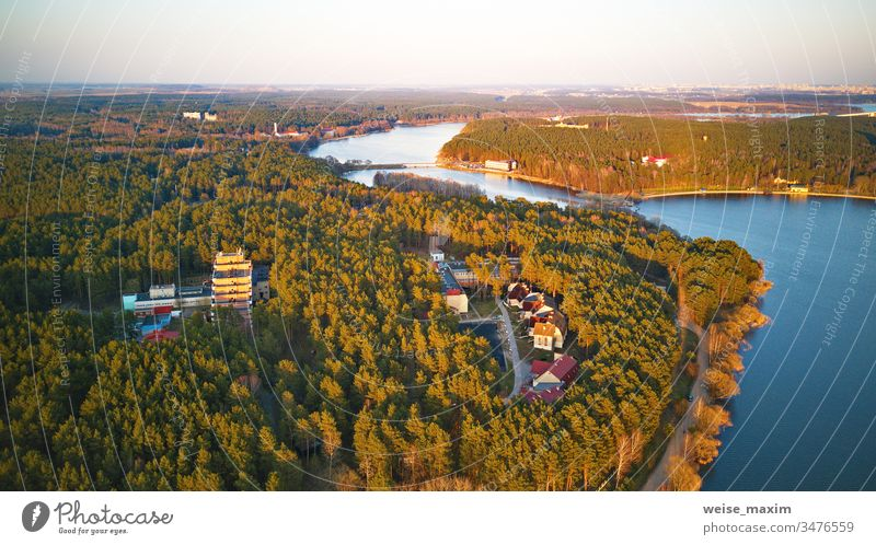 Recreation zone and big city aerial view. Riverbank with forest and sanatorium river lake spring shore park lakeside tree water riverbank panorama rural day