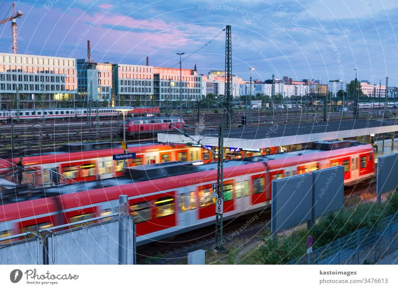 Railway with trains on Hackerbrucke train and S-bahn station in Munich, Germany munich train station railway transportation railroad day europe sky transit