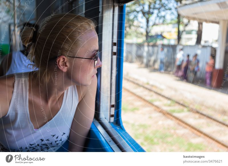 Young female adventurer traveling by train in Asia. woman journey transport passenger railway trip traveler transportation young person beautiful people