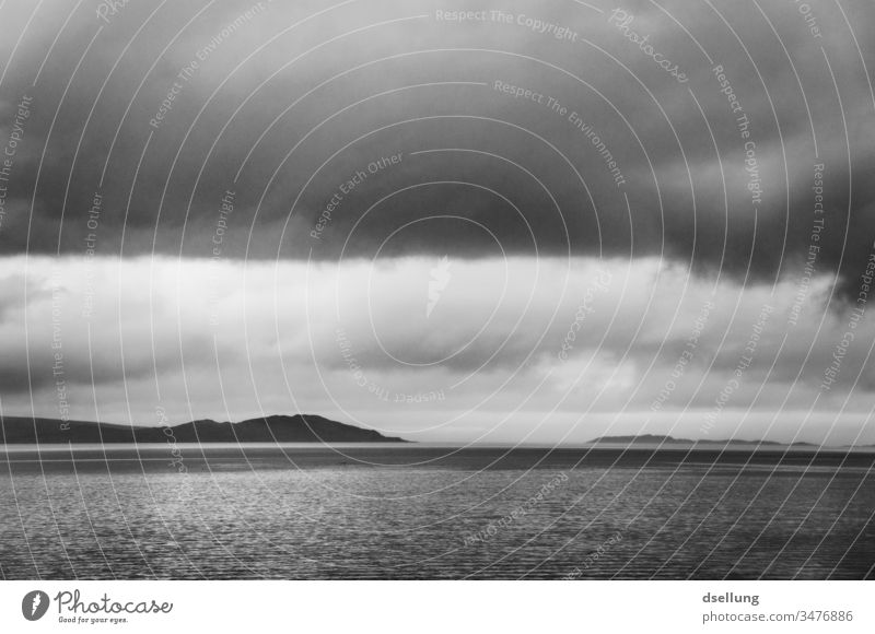 Black and white image of a lake in the Scottish Highlands under cloudy skies Panorama (View) Shadow Light Day Contrast Hollow Scotland Gray Wild natural chill