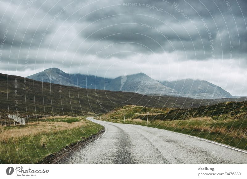 A road that winds through the Scottish Highlands towards a mountain Panorama (View) Day decelerated deceleration Target Lanes & trails Vacation & Travel Calm