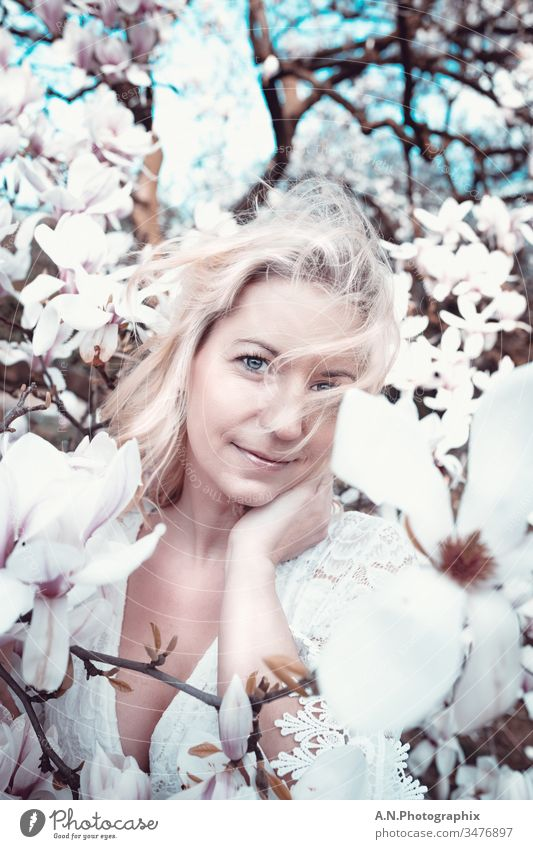 Beautiful blonde woman with white dress in a flower tree Portrait photograph Woman Blonde Tree out Nature Landscape Face Beauty & Beauty beautifully