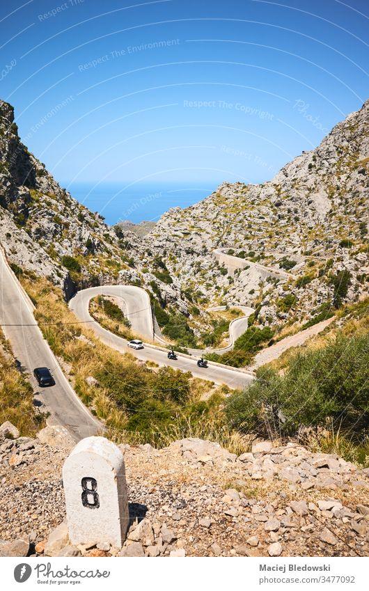 Curvy mountain road on the coast of Mallorca. Spain travel landscape drive journey trip sky sea curve winding steep nature