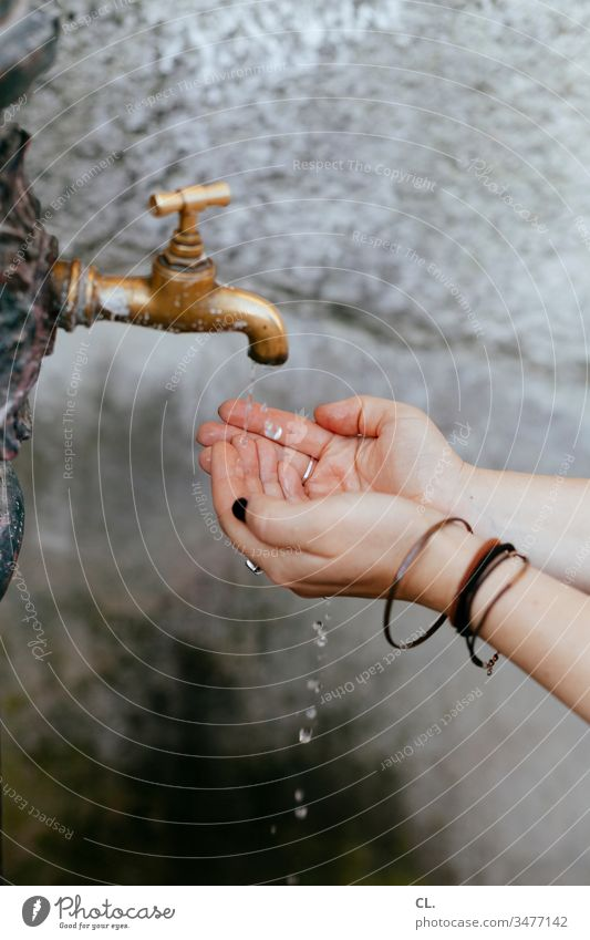woman washes her hands Water Tap Well Clean hygiene Woman neat Wash hands care Cleanliness Hand Drops of water out