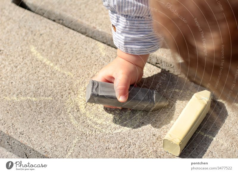 Toddler paints with street chalk. Painting (action, artwork) Children's game Sun Image Leisure and hobbies Colour photo Creativity Chalk Multicoloured