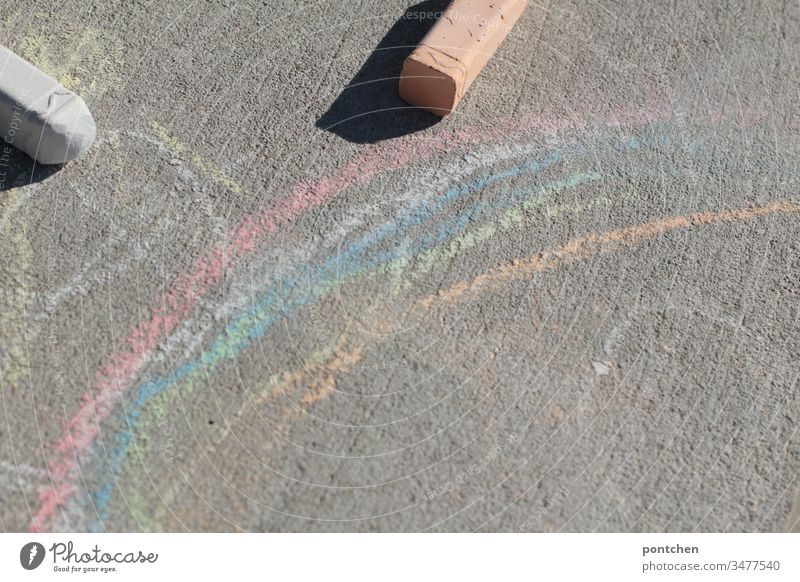 Rainbow painted with street chalk and two street chalk Street chalks Painting (action, artwork) Children's game Joy Creativity corona symbolism out Pastime