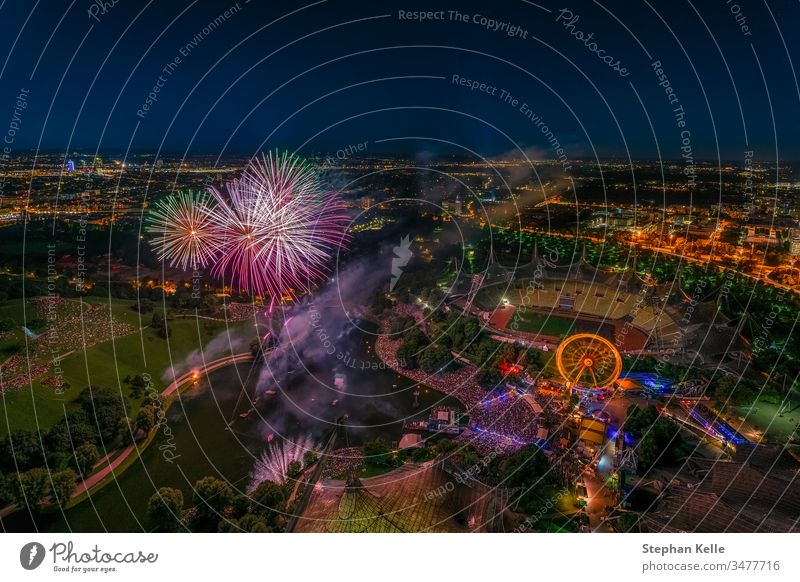 Fireworks over Munich from a high angle. firework munich muenchen celebrate festival city celebration tourism total colorful party holiday night cityscape light