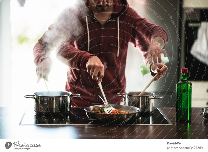 multitasking man Hausmann cooks several things at once under time pressure Man Talented swift Stress boil Hurry Photomontage Creativity Boil housework